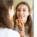 Постер, плакат: Young girl admiring in the mirror