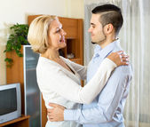 Woman and young boyfriend dancing — Stock Photo