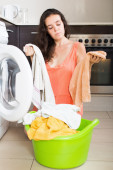 Woman  tired and washing clothes in machine — Stock Photo