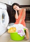 Tired woman near washing machine — Stock Photo