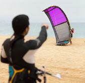 Family of kitesurfers at the  beach — Stock Photo