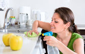 Woman doing chores in kitchen — Stock Photo