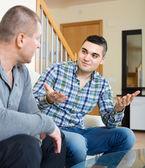 Conversation between two men indoor — Stock Photo