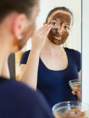 Girl applying mask for facial skin care — Stock Photo