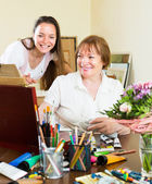 Happy woman artist with her admirer — Stock Photo