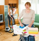Women doing house cleaning — Stock Photo