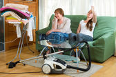 Two women having a rest after cleaning — Stock Photo