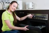 Woman cooking meal in the oven — Stock Photo