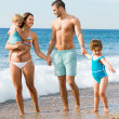 Family of four at the beach — Stock Photo #77491372