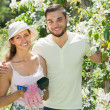 Young couple gardening together — Stock Photo #77491580