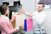 Client paying for new apparel at store — Stock Photo