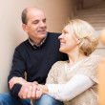 Mature couple near staircase — Stock Photo #79677482