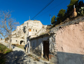 Village with dwelling  houses built into rock — Stock Photo