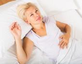 Mature lady in shirt awaking — Stock Photo