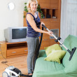 Woman cleaning with vacuum cleaner — Stock Photo #79682610