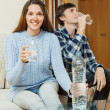 Couple in home drinking water — Stock Photo #79697192