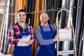 Worker  at factory with boss — Stock Photo