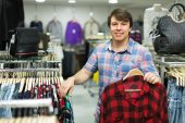 Male choosing shirts in the shop — Stock Photo