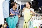 Couple choosing clothes — Stock Photo