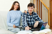 Man and woman prepare for examinations — Stock Photo