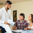 Salesman and young couple at home — Stock Photo #79935454