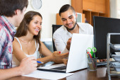 Colleagues watching at laptop — Stock Photo