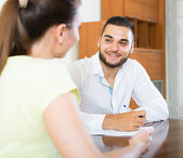 Pair discussing terms of contract — Stock Photo