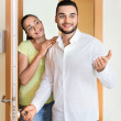 Merry couple coming to the apartment — Stock Photo #80311740