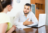 Couple with documents in apartment — Stock Photo