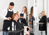 Mature woman in the barbershop — Stock Photo