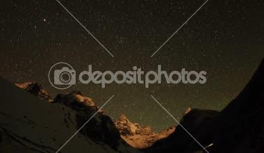 Time lapse of stars behind mountains Kyajo, Pharilapche, Machhermo Glacier. Nepal — Stock Video