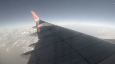Airplane wing out of window on blue sky background, Full HD (timeLapse) — Stock Video
