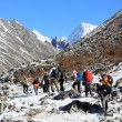 HIMALAYAS, NEPAL - MARCH, 2014: Group of tourists coming down fr — Stock Photo #56071971