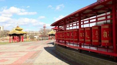 Tourists walk and spin prayer wheels at Golden Abode of Buddha Shakyamuni in Elista, Republic of Kalmykia, Russia on April 20, 2015, Full HD — Stock Video