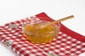 Honey in glass bowl — Stock Photo