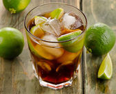 Cuba Libre with limes — Stock Photo
