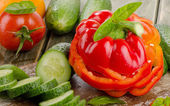 Red  paprika and cucumbers — Stock Photo