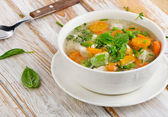 Soup on wooden table — Stock Photo