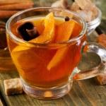 Christmas tea with orange, honey and spices — Stock Photo #55502663