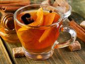 Christmas tea with orange, honey and spices — Stock Photo