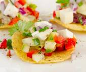 Corn nachos with vegetables and cheese. — Stock Photo