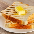 Slices of toast bread on plate — Stock Photo #59021625