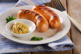 Two grilled sausages with mustard — Stock Photo