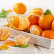 Ripe tangerines with leaves — Stock Photo #59509329