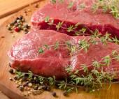 Raw beef steaks — Stock Photo