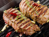 Beef steaks on   grill pan — Stock Photo