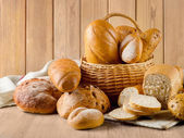 Bread loafs in basket — Stock Photo