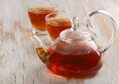Teapot and cups of tea — Stock Photo