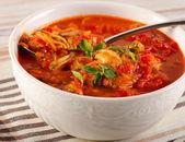 Bowl of seafood soup — Stock Photo