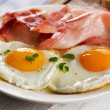 Two fried eggs and bacon for healthy breakfast — Stock Photo #65167403